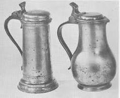 A ten and a quarter inch cylindrical lidded flagon with scroll handle and open shaped thumb piece and domed cover.It dates from the first half of the century. The bulbous shape next to it suggests its century date and is probably German. Pewter Tankard, Copper Accessories, Antique Pewter, 17th Century, Pottery, Ceramics, Antiques, Dates, Modern