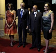President Obama and First lady Michelle Obama are greeted by South Africa's President Jacob Zuma and South African First lady Thobeka Madiba-Zuma at an official dinner in Pretoria on Saturday