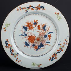 Description A Chinese Imari plate, painted in typical colours at the centre with a spray of peony & chrysanthemum, the border with three vignettes of prunus branches, heightened with enamel.  The 'Chrysanthemum', a frequent motif, symbolized autumn and was the crest of the imperial family.  Date Kangxi/Qianlong period, circa 1720-1740.  www.collectorstrade.de