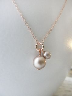Blush pearls on rose gold necklace - double pearl necklace - simple pearl jewelry. $34.00, via Etsy.