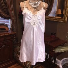 Romantic white lace and satin night gown. Victoria's Secret size medium lace and satin nightgown. Perfect for wedding night or Valentine's Day. Gorgeous in great shape. Victoria's Secret Intimates & Sleepwear Chemises & Slips