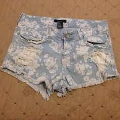 Blue flowered shorts Blue flowered distressed shorts, super cute for the beach, in great conditions Forever 21 Shorts Jean Shorts
