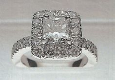 Princess cut in halo setting with diamonds going down sides of shank