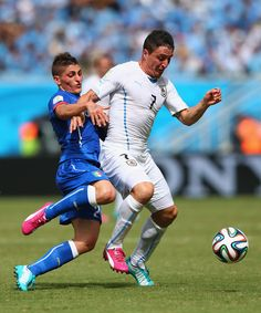 Marco Verratti of Italy challenges Cristian Rodriguez of Uruguay during the 2014 FIFA World Cup Brazil Group D match between Italy and Urugu...