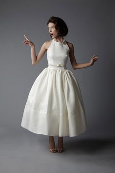 Supercute vintage-style tea length wedding gown. I'd want more detail and a flattering fit in the bust, but I love the shape of this gown!