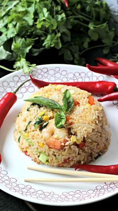 Quick, easy and flavorful thai fried rice made with shrimp and chili peppers for some heat. Perfect weeknight meal.