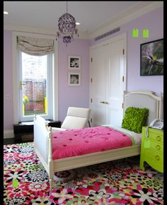Pale lavendar walls with hot vibrant colors