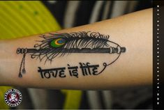 peacock feather with flute tattoo - Black Poison Tattoo Studio