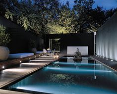Sleek contemporary pool and landscape with Buddha feature. Nice accent lighting too. Pinned to Pool Design by BASK Pool Design.