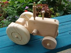 Items similar to Handmade wooden toy tractor, wooden car on Etsy Wooden Toy Trucks, Wooden Car, Making Wooden Toys, Handmade Wooden Toys, Woodworking Toys, Woodworking Projects Diy, Wooden Toys For Toddlers, Wood Toys Plans, Tractors