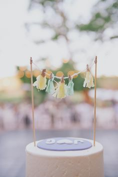 yellow and green wedding cake topper http://www.weddingchicks.com/2013/09/25/rustic-summer-wedding/