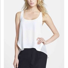 """NWT Topshop Contrast Panel Seam Tank - White Brand new Topshop Contrast Panel Seam Tank in white. Super light, breezy top with a sheer back panel and a high/low hemline. 24"""" in front, 27"""" in back. No trades. Topshop Tops Tank Tops"""