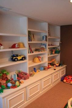 Basement idea - since my kids are beyond the baby/toddler toys we could do legos, board games, videos, etc on the shelves. No basement.Good for the playroom in the formal living room for the not so formal family Basement Makeover, Basement Renovations, Basement Ideas, Playroom Ideas, Playroom Storage, Lego Storage, Wall Storage, Toy Storage Shelves, Board Game Storage