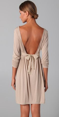 love the color---and it's backless...with a bow.. im in love with this dress.