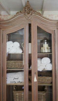 Like the Amoire for bath storage  FRENCH COUNTRY COTTAGE: Crushing on~ Baskets