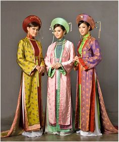 """Indonesian women wear the kebaya -- a beautiful, figure-hugging embroidered blouse worn with a batik sarong, usually dyed with flower motifs/bright colours… often tie their hair into a bun, or attach a false hairpiece… may drape a long stretch of cloth, called """"selendang"""", over one shoulder, used as a head shawl or on less formal occasions, used to carry babies or objects."""