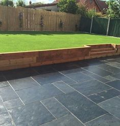 Browse images of black modern Garden designs: GALAXY SANDSTONE PAVING. Find the best photos for ideas & inspiration to create your perfect home. Garden Retaining Wall, Garden Paving, Sloped Garden, Garden Shrubs, Sleeper Retaining Wall, Retaining Walls, Back Garden Design, Modern Garden Design, Backyard Garden Design