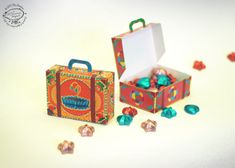 Here's a set of colorful mini suitcases, to store your visiting cards, knick-knacks or use as party favor boxes. This DIY paper template is lovingly