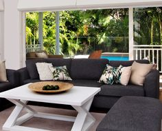 Our ever popular palm print cushions on sofas made by Beachwood. Oak coffee table with white finish.