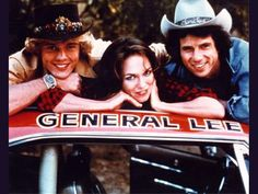 The Dukes and their car The General Lee.My son still has that car~~