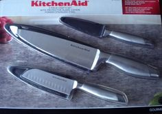 Kitchenaid Knife Set Stainless Steel 3 Pieces by Kitchen Aid. $34.99. Includes: 8 inch chef knife, 4 1/2 inch santoku knife, 3 1/2 inch paring knife, and 3 protective covers (one for each knife). Knives: hand wash only, Blade covers: dishwasher safe. Construction- Heat-tempered for outstanding strength and durability. Bolster- Properly weighted for balance and control, Handle- Comfortable grip on brushed stainless steel. Blade- Japanese high-carbon stainless steel with the...