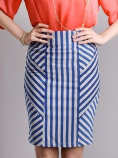 have an almost identical skirt in black & tan ...but love the blue too