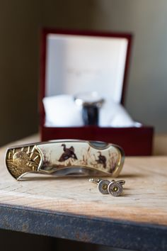 Cuff links, a custom pocket knife, and a watch make for a very dapper groomsmen gift!