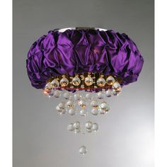 Add some elegance to your home with this chrome-finished Wine Velvet crystal chandelier. This dynamic lighting element features generous rows of cascading crystals to catch the light.