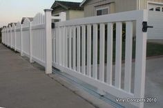 Rolling gate in closed picket design. 3 inch wide pickets for a more secluded look. Gate is shown partially open. Great for the deck to keep the dogs from getting out. Driveway Fence, Backyard Gates, Front Yard Fence, Garden Gates, Diy Fence, Pool Gates, Porch Gate, Deck Gate, Wood Fence Design