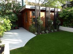 modern minimalist garden design low maintenance high impact garden design raised white wall beds grey decking east grass lawn turf sunken garden with fire and chimney flat trees balham wandsworth london (2)