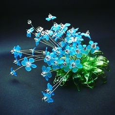 Made from #recycled #plastic #bottles by Aurora Robson. Beautiful work…