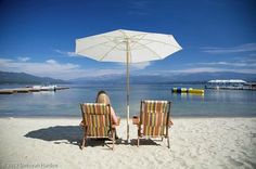 Lounging on Payette Lake's sandy beach makes for the ideal summer retreat (98479189)