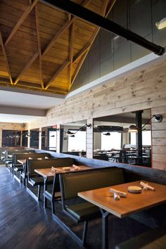 Diner format with industrial style- wood finishes, high ceilings