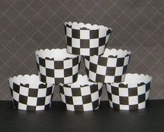 Hey, I found this really awesome Etsy listing at http://www.etsy.com/listing/64997260/checkered-flag-cupcake-wrappers