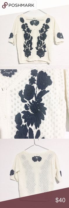 Navy Embroidered Flower Beaded Cardigan Absolutely gorgeous detail! The flowers are a dark navy with beautiful beading on the front flowers. Sweaters Cardigans