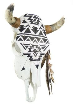 Navajo Cow Skull: Gina Rodriguez owns one of our first renditions of this black and white hand painted cow skull. Hand Painted. Cabin, Native American Accent.