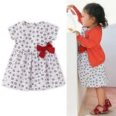 Petit Bateau Floral Bow Dress is on SALE! Made in poplin printed with little flowers, this baby girl short-sleeved dress has a delightful big bow. eversimplicity.com