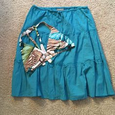 Tommy Bahama Bikini top and skirt Tommy Bahama bikini top and skirt.  The skirt is a beautiful turquoise color and is a small. Looks great with this bikini top. The top isn't sizes but I am a 36c and fits me perfectly. Great for the beach! Both were only worn twice. Excellent condition. Tommy Bahama Swim Bikinis