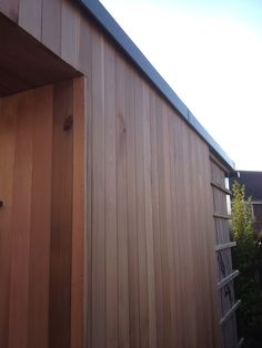 Part finished garden room being clad in red cedar
