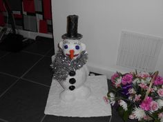 Snowman I made for my granddaughter from plastic bottle, clay and pva glue