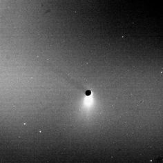 """""""Blazing like an icy torch, the plume of Enceladus shines in scattered sunlight as the moon casts a shadow onto Saturn's E ring"""""""
