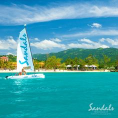 Sail on the beautiful turquoise sea at #SandalsSouthCoast | Sandals Resorts | Jamaica