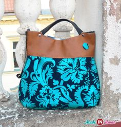 Handbag, ideal friend in town :-)  It is made from 100% cotton with a beautiful pattern in blue and turquoise and brown leather. The entire bag is reinforced and lined.  You can wear it in your hand or over the shoulder or as a cross body.