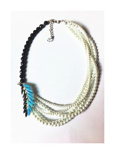 This necklace is a beautiful example of old meeting new. The turquoise and black feather brooch is a blessed vintage find. What happens when you pair