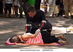RIO DE JANEIRO, BRAZIL - FEBRUARY 1: Brazilian soap opera episode is being filmed in the street on 1 February 2014. Young woman hit by the bus is getting first medical aid. - stock photo