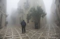"""The fork"". An elderly man is seen while walking the streets of Erice in Sicily. (Photo and caption by Giorgio Bianchi/National Geographic Photo Contest) Trapani Sicily, Sicily Italy, National Geographic Photo Contest, Forest Road, Future Travel, Winter Landscape, Photo Location, The Good Place, Places To Go"