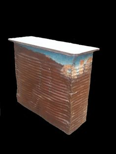 A bar made from an old ELF oil drum covered with a rough concrete plateau rimmed with rusty metal. Drum Cover, Oil Drum, Rusty Metal, Drums, Barrel, Recycling, Outdoor Decor, Ideas, Rusted Metal