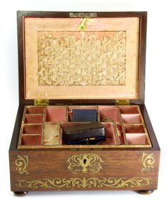 Lot 324 - A brass inlaid 19th century workbox and contents including an ivory needle case with stanhope, a