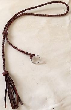 A personal favorite from my Etsy shop https://www.etsy.com/listing/268174696/adjustable-braided-leather-lanyard