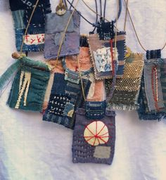 Badges for especially zen lessons? amulets stitched from tiny bits of antique textiles - a Boro / sashiko feel to them Textile Jewelry, Fabric Jewelry, Textile Art, Jewellery, Textile Fabrics, Diy Jewelry, Handmade Jewelry, Fabric Beads, Fabric Art